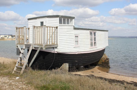 portsmouth: A houseboat in langstone harbour in england Stock Photo