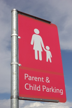 A Parent   child parking sign for parents who drive and require parking photo