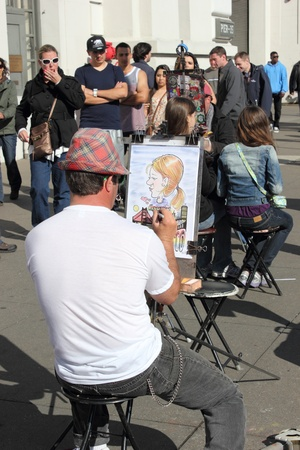 Caricature artist on the streets of San Francisco,fishermans wharf, march 2013