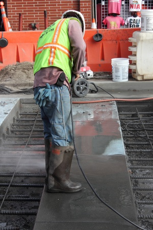 A worker wearing his personal protection equipment while working and repairing the streets of san francisco, march 2013