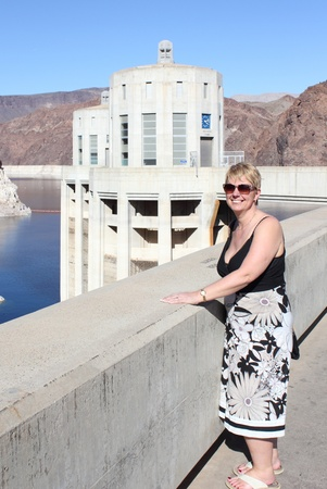 The famous Hoover Dam with a lady in the shot, between Arizona and Nevada - USA, april 2013