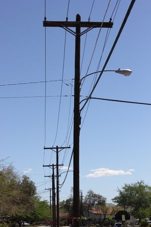 Telegraph poles against a blue sky in the american Boulder city, april 2013