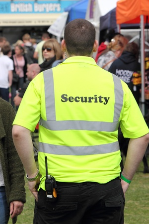 Security person on patrol and surveillance at the New forest spring fair,hampshire,england, 5th may 2013 Stock Photo - 19415541