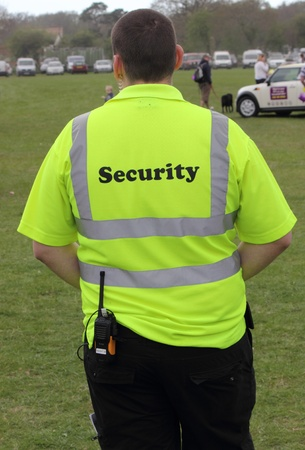 Security person on patrol and surveillance at the New forest spring fair,hampshire,england, 5th may 2013