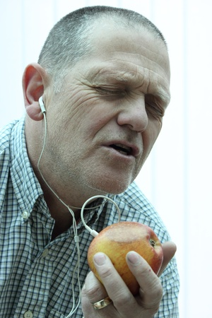 A male with his own interpretation of an I-pod with an apple photo