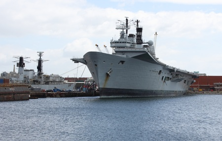 scraped:  An old redundant aircraft carrier which is due to be scraped, may 2013