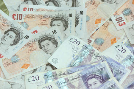 A pile of english £10 and £20 notes  Stock Photo