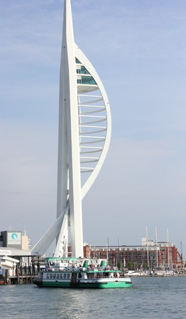 Portsmouth, UK,May 19, 2013: Built to celebrate the millenium and situated on the historic Gunwharf Quays in Portsmouth, the 560ft (170m) Spinnaker Tower has the highest tourist observation platform in the UK.The gosport passenger ferry is also in view  Editorial