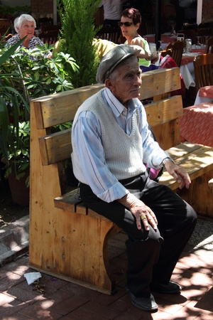 turkish man: An old turkish man sitting and having a rest on a chair at a local market in Fethiye, Turkey, 30th may 2013