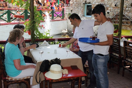 resturant: Tourists being served in a traditional Turkish resturant in fethiye, turkey,29th May 2013