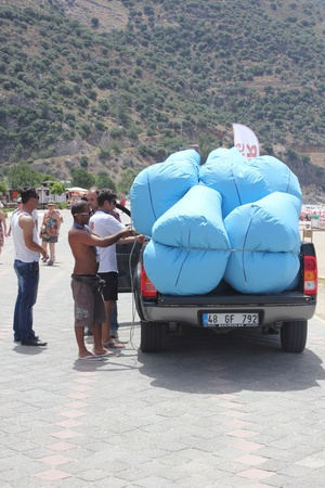 Turkish male workers unloading new soft seating for the beach at Oludeniz ,Turkey, May 2013