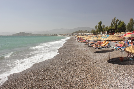 Calis beach with sunbathers in Turkey,2nd june 2013