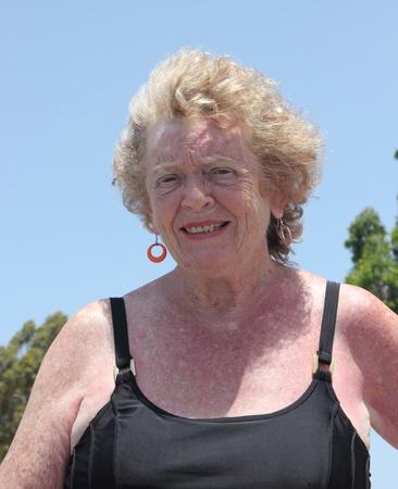 an old english lady enjoying the sunshine while on holiday