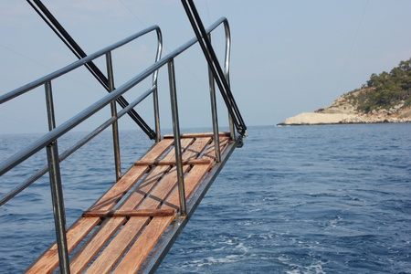 gangway: Gangway of a motorboat at sea Stock Photo
