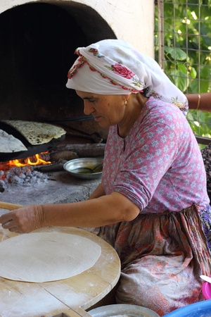 TURKEY,CALIS, 1st AUGUST 2013 - Old Turkish ladies making traditional turkish bread and pancakes