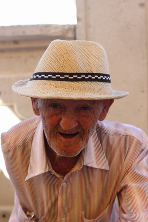 TURKEY, JULY, 2013 - An old Turkish unshaven male wearing a hat