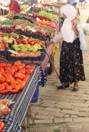 An old lady buying her fruit and vegetables at a local market in Turkey, July  2013