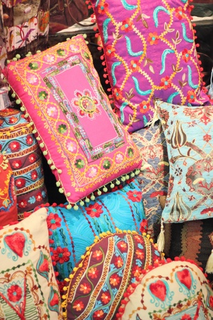 Fabrics, textiles and turkish rugs at a bazaar in Turkey photo