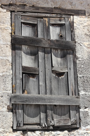 Very old window of housing at Fethiye in Turkey photo