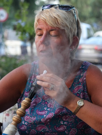 Lady smoking a hookah water pipe in Turkey, July 2013 photo