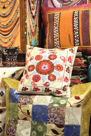 Fabrics, textiles and turkish rugs for sale at the local bazaar in Fethiye, Turkey ,July ,2013