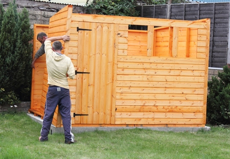 hobby hut: Building a wooden shed and fixing the panels together and to the base Stock Photo