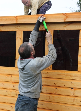 tongue and groove: Building a wooden shed Stock Photo
