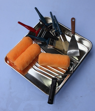 paintroller: A decorators industrial metal paint tray with rollers, scraper and an assortment of brushes Stock Photo
