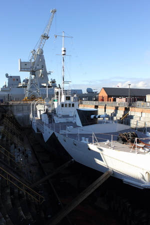 minerva: 1st world war ship M33 with the modern HMS dauntless in the Background Editorial