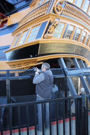 hms: A Tourist visiting and photographing Hms victory which was Admiral Lord Nelsons flagship