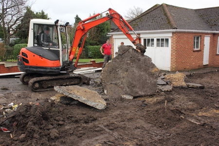 site: A mini digger being used in the preparation of groundwork for the laying of blockpaving Editorial