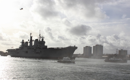 portsmouth: PORTSMOUTH, ENGLAND, 10TH JANUARY 2014  HMS Illustrious,the aircraft carrier returns to portsmouth after its deployment to the Philippines,
