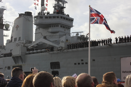 illustrious:  PORTSMOUTH, ENGLAND, 10TH JANUARY 2014  HMS Illustrious,the aircraft carrier returns to portsmouth with family and friends awaiting on the dockside after its deployment to the Philippines Editorial