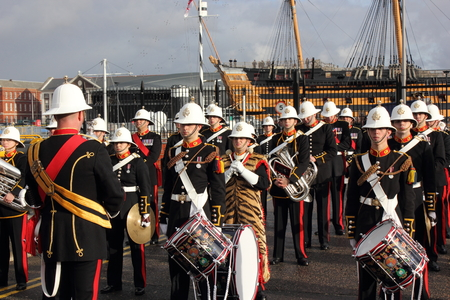illustrious:  PORTSMOUTH, ENGLAND, 10TH JANUARY 2014 The Royal Marines marching band playing on the return of HMS Illustrious,the aircraft carrier to portsmouth after its deployment to the Philippines