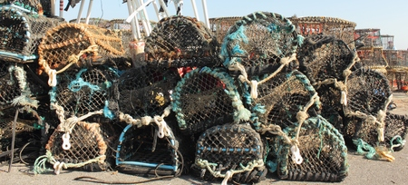 Lobster and crab pots on the quayside photo