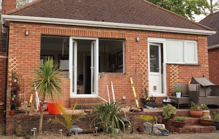 renewing: Renewing plastic doors and windows to a bungalow