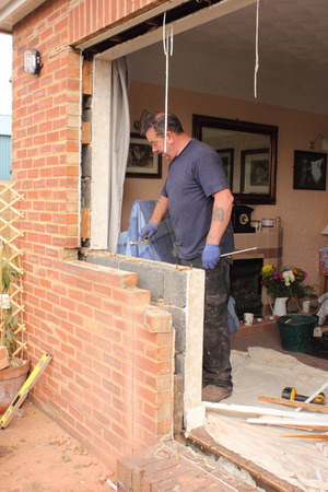 renewing: A window fitter renewing plastic doors and windows to a bungalow Stock Photo