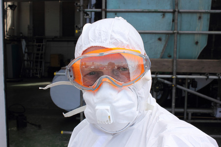 Industrial Cleaner wearing his full ppe for a steam boiler clean
