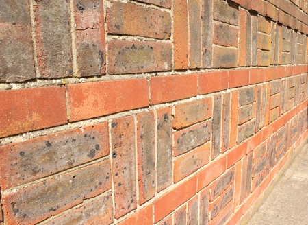 good quality: A square patterned brickwall built with good quality red bricks