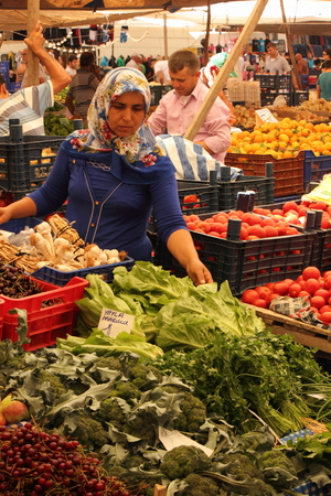 CALIS, TURKEY - 20TH JULY, 2014 A turkish lady selling her fresh fruits and vegetables at a local produce market in Calis, Turkey 20th july 2014