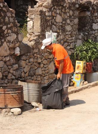 turkish man: A turkish man emptying waste bins along the streets in fethiye in turkey, july 2014 Editorial