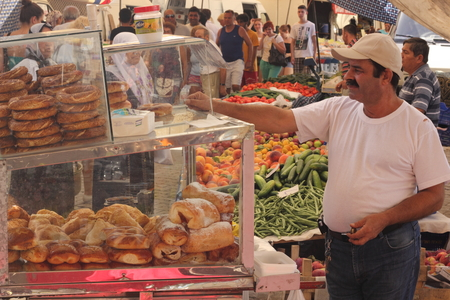 turkish man: An old turkish man selling his pastries from a cart at a local market in calis, turkey 2014