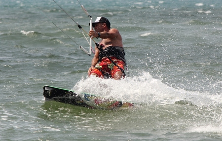described: TURKEY,CALIS,JULY 2014 -Kite surfing is an extreme adventure sport described as a combination of wakeboarding windsurfing and paragliding