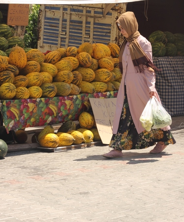 A turkish lady with her purchases from a local market in calis, turkey 2014