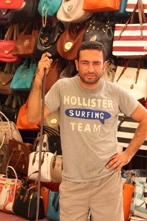 beachbag: A market stall selling his fake handbags to the tourists in calis, turkey 2014