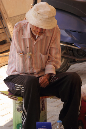turkish man: A one armed old turkish man sitting down and having a rest, 2014