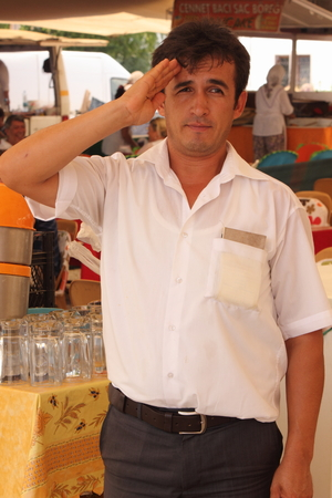 turkish man: A turkish man giving a salute