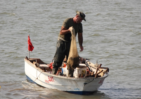 A turkish fisherman with his nets for catching his fish