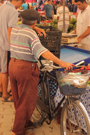 turkish man: A turkish man selling his goods from his bicycle at a turkish market in calis in turkey, 2014