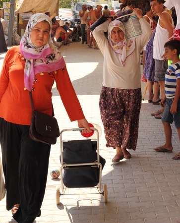 Turkish ladies shopping at a local market in calis, turkey 2014